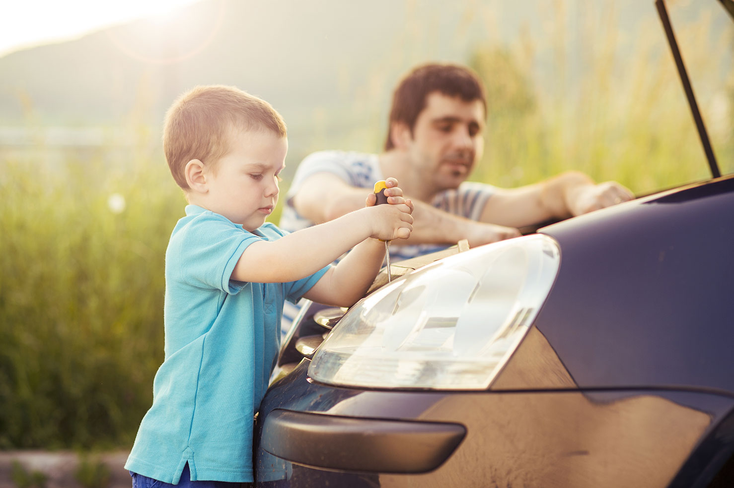 young-father-with-his-little-son-repairing-car